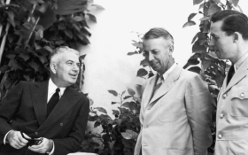"""From left, Puerto Rican Governor Rexford Guy Tugwell chats with Elmer Ellsworth, a PPD official, and naval officer Vernon de Mars at La Fortaleza, the governor's residence in San Juan. Tugwell's successor, Resident Commissioner <a title=""""Jesús T. Piñero"""" href=""""/People/Detail/19726?ret=True"""">Jesús T. Piñero</a>, became the first native-born Puerto Rican to serve as governor of the island."""