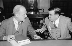 "Senator <a title=""Dennis Chavez"" href=""/People/Detail/10875?ret=True"">Dennis Chavez</a> of New Mexico (right) discusses the installation of government radio stations with law professor Herbert Wright of The Catholic University of America during a Senate Interstate Commerce Committee hearing in May 1938."