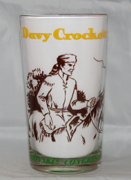 "Thanks to a 1950s TV series, the legend of David ""Davy"" Crockett grew, leading to merchandise like lunchboxes, bubblegum, and the drinking glass pictured above."