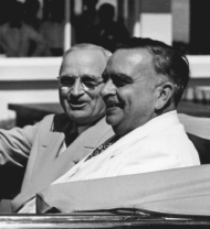 President Harry S. Truman (left) rides in an open car in Puerto Rico in 1947 seated next to Governor Jesús Piñero. A year earlier, Truman had appointed Piñero as the first native Puerto Rican governor of the island. Piñero had previously served as Resident Commissioner in the U.S. House.