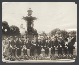 Committee Members Sit on the Edge of the Bartholdi Fountain