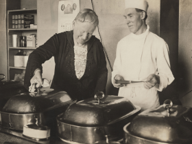 Alice Robertson, who owned and operated a dairy farm with an on-site café, is seen here being shown the kitchen of the United States Capitol café.