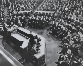 """Members of the Supreme Court often choose to attend the President's <a title=""""State of the Union Address"""" href=""""/Institution/SOTU/State-of-the-Union/"""">State of the Union Address</a>, as seen seated in the front row at the top of this photograph of President <a title=""""Lyndon B. Johnson's"""" href=""""/People/Detail/15895?ret=True"""">Lyndon B. Johnson's</a> 1965 speech."""