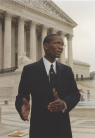 """Representative <a href=""""/People/Detail/13112?ret=True"""" title=""""Cleo Fields"""">Cleo Fields</a> meets reporters outside the Supreme Court after the court rejected the redistricting challenge that threatened his district."""