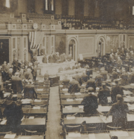<p>The turn of the twentieth century ushered in the regular appearance of a flag behind the Speaker's rostrum.</p>