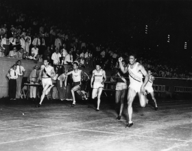 Representative Ralph Metcalfe of Illinois achieved worldwide fame as an Olympic athlete years before he became involved in politics on Chicago's South Side. He is pictured above running as a member of the Marquette University track team in 1933.