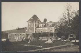 <p>Someone took a photograph of Congressman Plumley's house and had it printed as a postcard. Was it perhaps the proud aunt of Plumley's staffer?</p>