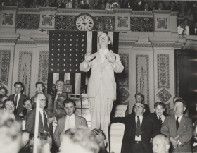 "This 1934 photograph shows Representative <a href=""/People/Detail/11324?ret=True"" title=""William Connery, Jr."">William Connery, Jr.</a>, belting out a tune in the House Chamber. His solo came shortly after the second session of the <a title=""73rd Congress"" href=""/Congressional-Overview/Profiles/73rd/"">73rd Congress</a> (1933–1935) adjourned, in what was once a House tradition."