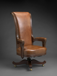 The tall-backed Speaker chair carried over into the renovated Chamber. An identical chair remains in use today.