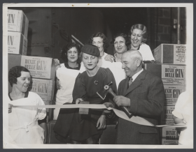 Fred Britten Cuts a Ribbon at the Continental Distillery