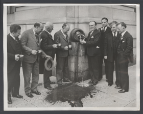 Representatives Pour Beer from a Keg