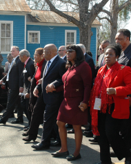 "Members of Congress march to the Edmund Pettus Bridge in Selma during the 2014 Congressional Civil Rights Pilgrimage. (From left to right: Senator Tim Kaine of Virginia, <a href=""/People/Detail/11348?ret=True"" title=""John Conyers"">John Conyers</a> of Michigan, <a href=""/People/Detail/19016?ret=True"" title=""Eleanor Holmes Norton"">Eleanor Holmes Norton</a> of the District of Columbia, <a href=""/People/Detail/16948?ret=True"" title=""John Lewis"">John Lewis</a> of Georgia, <a href=""/People/Detail/22624?ret=True"" title=""Terri Sewell"">Terri Sewell</a> of Alabama, and <a href=""/People/Detail/15730?ret=True"" title=""Sheila Jackson Lee"">Sheila Jackson Lee</a> of Texas)."