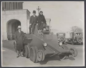 Photograph of Edith Nourse Rogers atop an army tank outside the Capitol in 1931.
