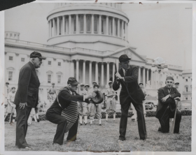 "House Leadership took to the Capitol Lawn for a friendly game on an April afternoon in 1938. Speaker <a href=""/People/Detail/7674"" title=""William Bankhead"">William Bankhead</a> took up the bat, with Majority Leader <a href=""/People/Detail/20184"" title=""Sam Rayburn"">Sam Rayburn</a> catching and Minority Leader <a href=""/People/Detail/21938"" title=""Bertrand Snell"">Bertrand Snell</a> serving as umpire."