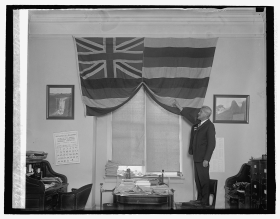 William Jarrett with the Hawaiian Flag