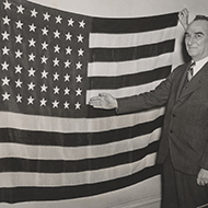 Samuel King with a 49-Star U.S. Flag