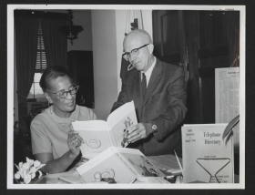 Representative Gus Hawkins and Juanita Barbee Examine a Book