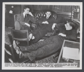 Weary Page Boys Relaxing in a Capitol Cloakroom