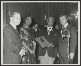 "(From left to right) Speaker <a href=""/People/Detail/8360"" title=""Carl Albert"">Carl Albert</a>, Jeannette Petinaud (Ernest Petinaud's wife), awardee and House Restaurant Headwaiter Ernest Petinaud, and Sergeant at Arms <a href=""/People/Detail/38410"" title=""Kenneth R. Harding"">Kenneth R. Harding</a>, pose during the 1973 McCormack award ceremony."