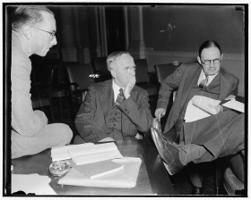 Middleton Beaman (center) with others in a US House hearing room