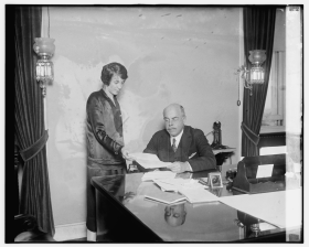 Nicholas Longworth consults with Mildred Reeves