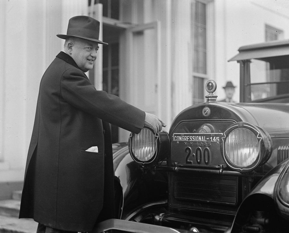 Bertrand Snell Pointing at His Congressional License Plate