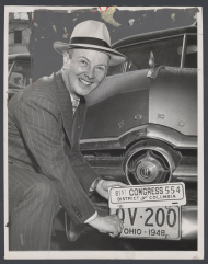Stephen Young Attaching a Congressional License Plate