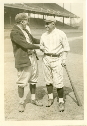 Representatives Clyde Kelly and Thomas McMillan shake hands before the start of a game at Griffith Stadium.