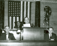<em>House Reading Clerk Joe Bartlett at the Speaker's Rostrum</em>