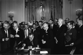On July 2, 1964, President Lyndon B. Johnson signed the Civil Rights Act of 1964 into law.