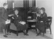 Representatives Florence Kahn and Edith Nourse Rogers (featured with a telephone) meet in the Ladies' Cloakroom in 1927.