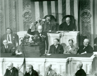 Winston Churchill earned the distinction of being the only foreign leader to address Congress three times. In this 1943 Joint Session, network microphones surround the podium.