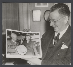 Dr. George Calver, Congressional Physician, Holds a Picture with Two Cherished Autographs